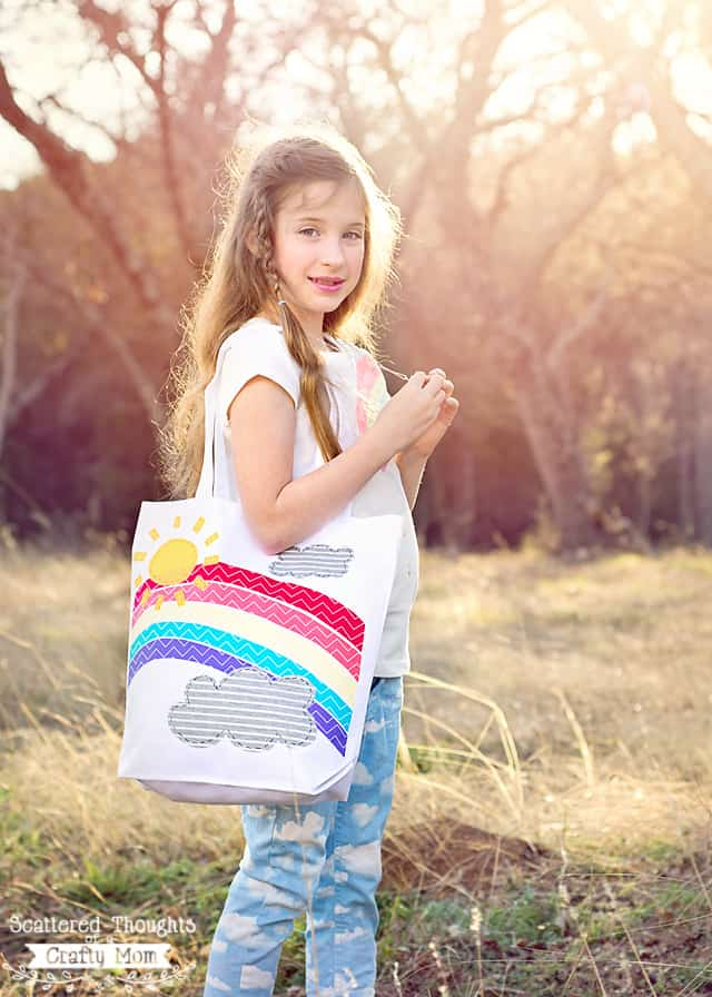 Make this adorable No Sew Applique Rainbow Tote in just a few minutes using a store bought tote bag, iron-on adhesive and fabric scraps!