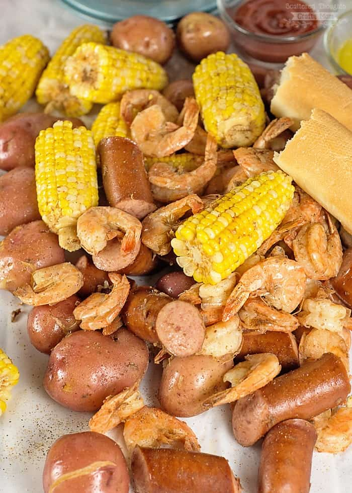 Low Country Shrimp Boil in a Pressure Cooker brings together shrimp, sausage, potatoes and corn in a delightfully spicy one pot meal. It's a great way to celebrate summer and warm weather with friends and family!