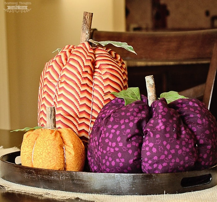 These Colorful Fabric Pumpkins are so simple to make - either with hand sewing and glue or by machine!