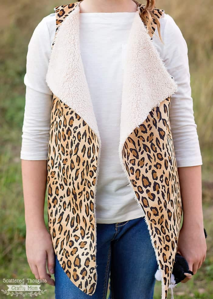 This free Girls Faux Shearling Vest Pattern is so easy to sew (2 pattern pieces, 3 seams and no hemming) and is a perfect layering piece!