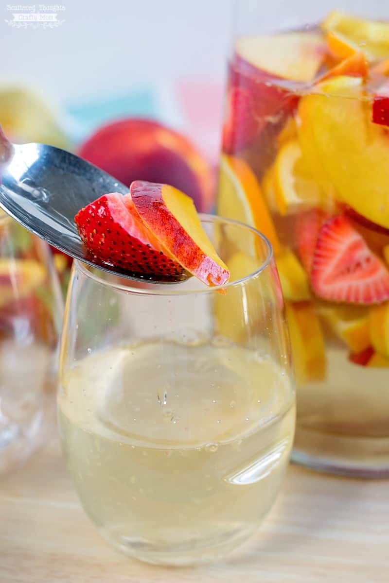 This Sparkling Summer Peach Sangria Recipe is cool, refreshing and the perfect summer drink to make any occasion special!