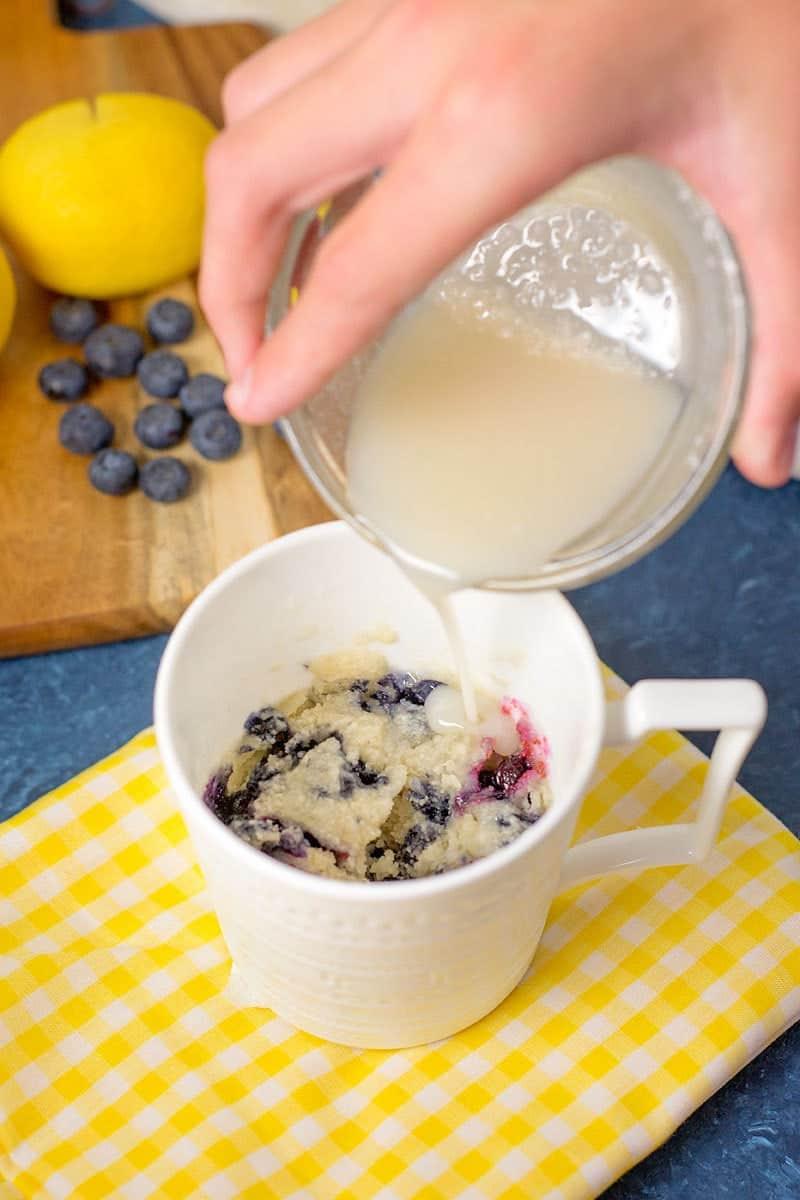 Blueberry mug cake with lemon drizzle